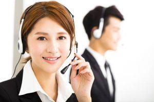 Young-Business-People-Working-With-Headset-In-Office