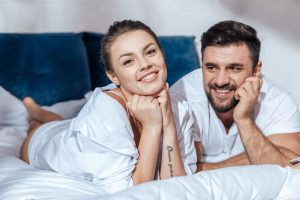 depositphotos_156878758-stock-photo-loving-couple-in-bed